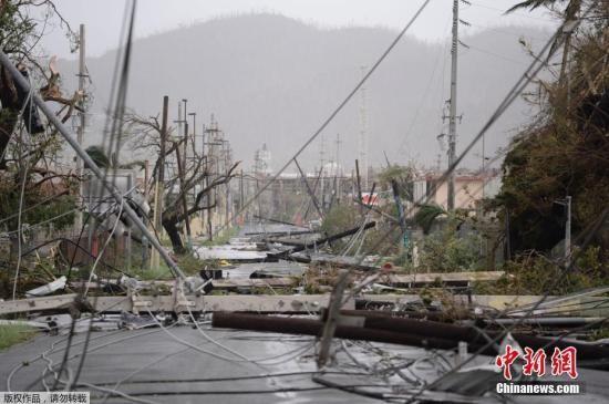 """飓风""""玛利亚""""致波多黎各水坝溃决 7万人疏散"""